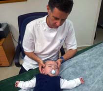 Performing craniosacral treatment on a baby